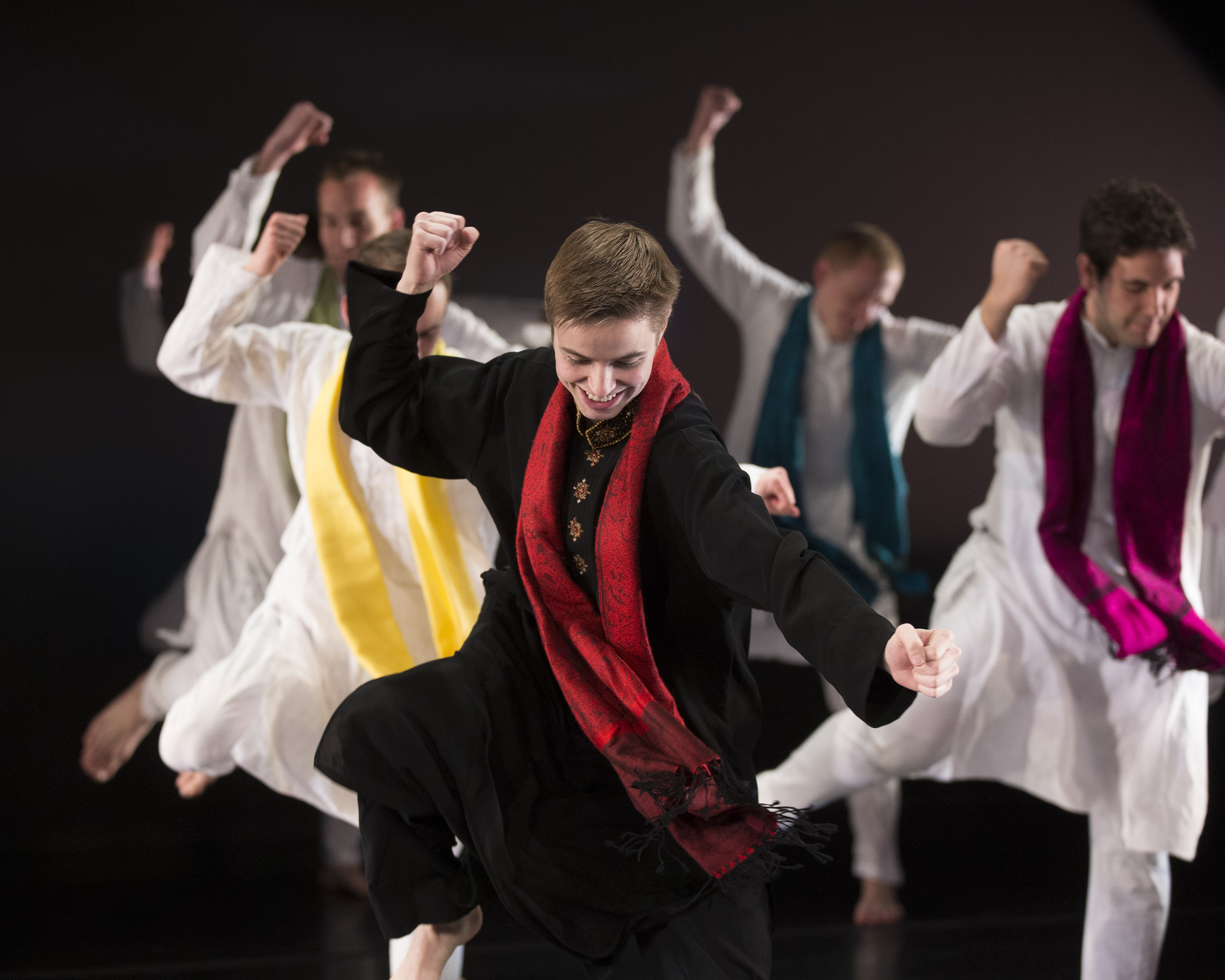 "Folk Dance Soloist Drew Wilde and men of International Folk Dance Ensemble performing an Indian Bollywood dance, ""Nagada Nagada"" in 2013.
