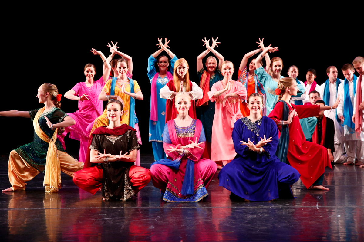 International Folk Dance Ensemble members (top row) Breanna Daniels, Amanda Alley, Mary Beth Johnson, Katie Haddock; (middle row) Ariel Peterson, Tia Haycock, Rebecca Kiser (soloist), Allyssa Pehrson, Whitney DeMille; (bottom row) Emily Huckstep, Julianna Bateman, Victoria Ringer, Carissa Moser, and Sirie McCoy performing an Indian Bollywood dance, 'Nagada Nagada.'