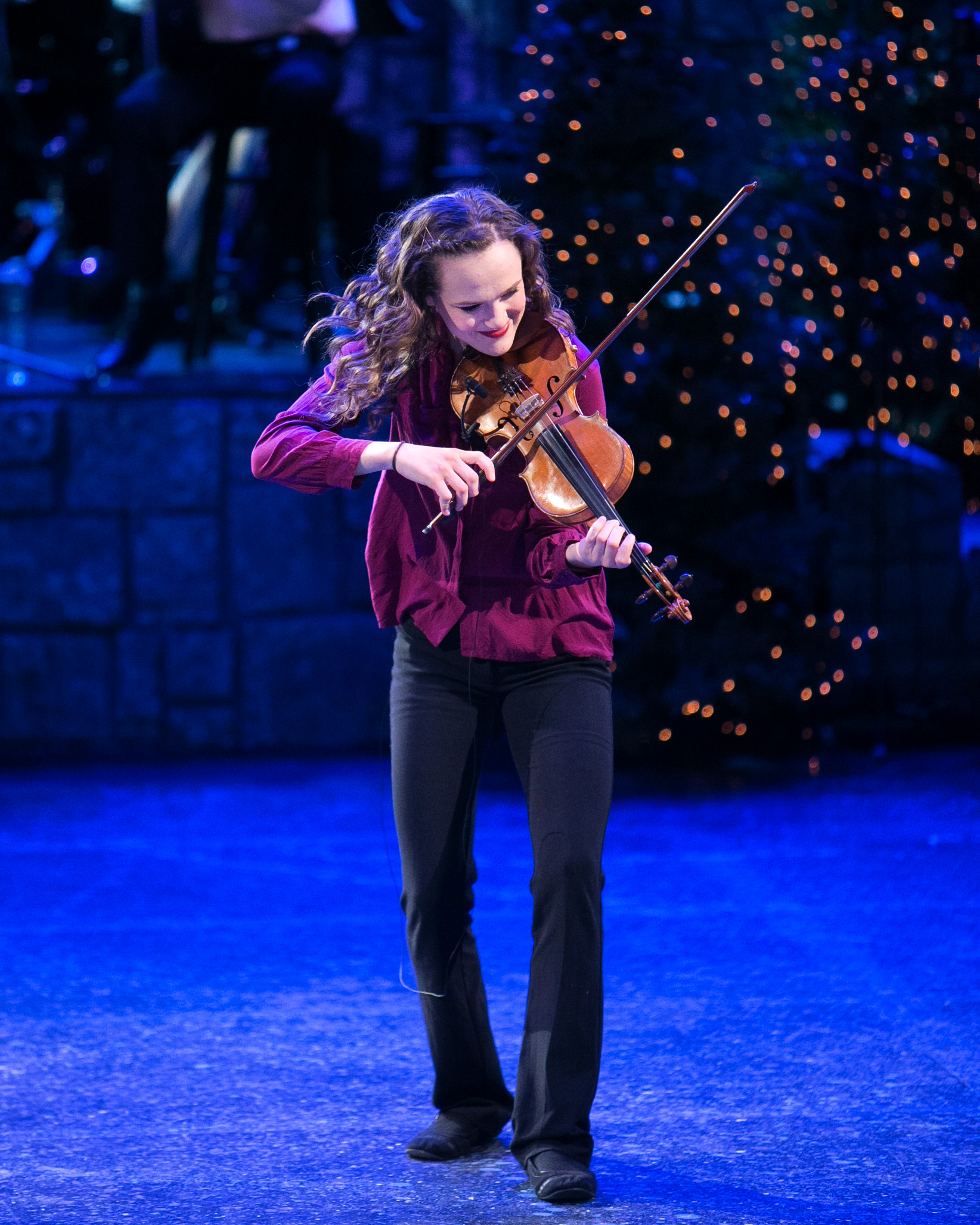 Aurianna Mann performing a fiddle solo for Mountain Strings at Christmas Around the World.