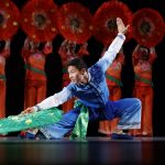 Folk Dancer, Ken Nukaya performs the 'Red and Green' dance celebrating the Chinese culture. 