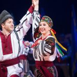 Folk Dancers Christian Hansen and Allison Moon performing 'Pryvit'- a dance showcasing four styles of Ukrainian dance, pictured is the Hopak. Performed at BYU's 2016 Christmas Around the World. 