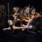 The Chamber Orchestra's violinists during a concert in Manila, Philippines.   Photo by Jaren Wilkey/BYU  © BYU PHOTO 2017 All Rights Reserved photo@byu.edu  (801)422-7322