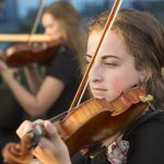 BYU Chamber Orchestra's member Christina McKell playing the violin in a concert in Venice, Italy. Photography by Mark A. Philbrick. Copyright BYU Photo 2014.