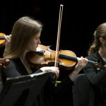 Violinists Kirsten Skabelund and Erin Durham exhibit intensity and emotion during a Brigham Young University Chamber Orchestra performance.   Photography by Mark A. Philbrick  Copyright BYU Photo 2012 All Rights Reserved photo@byu.edu  (801)422-7322