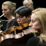 Violinist Brian Lew of the Brigham Young University's Chamber Orchestra, strive to convey a meaningful message during a performance in the de Jong Concert Hall on the BYU Campus.   Photography by Mark A. Philbrick  Copyright BYU Photo 2012 All Rights Reserved photo@byu.edu  (801)422-7322