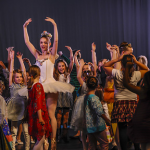 A Theatre Ballet member dances with the children at the Prince and Princess Party.