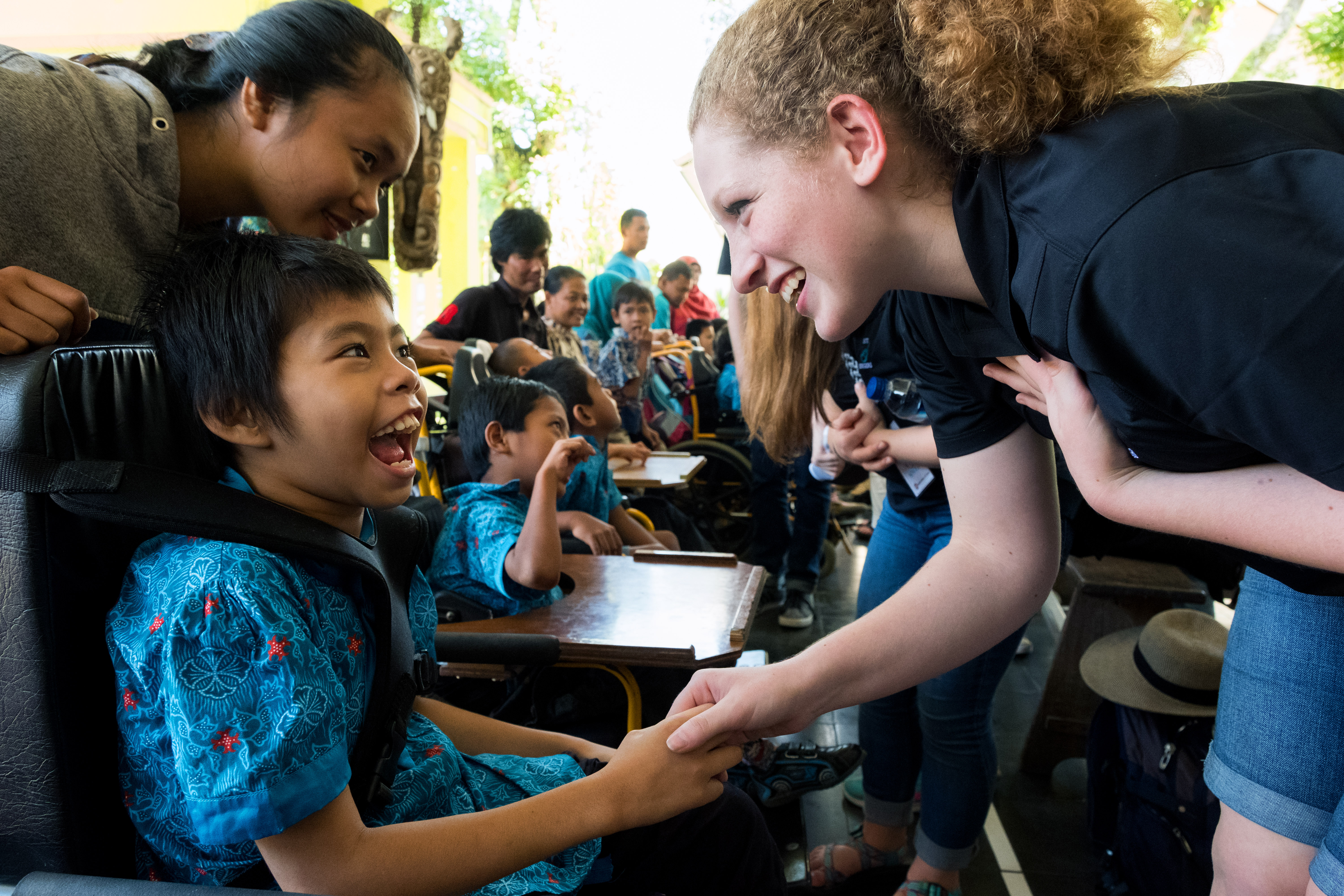 The BYU Singers spent part of their time at the Yakkum Handicapped Rehabilitation Center working with the children there.  BYU/Jaren  ©2017 BYU PERFORMANCE ART MANAGEMENT All rights reserved.   BYU PAM (801) 422-3576