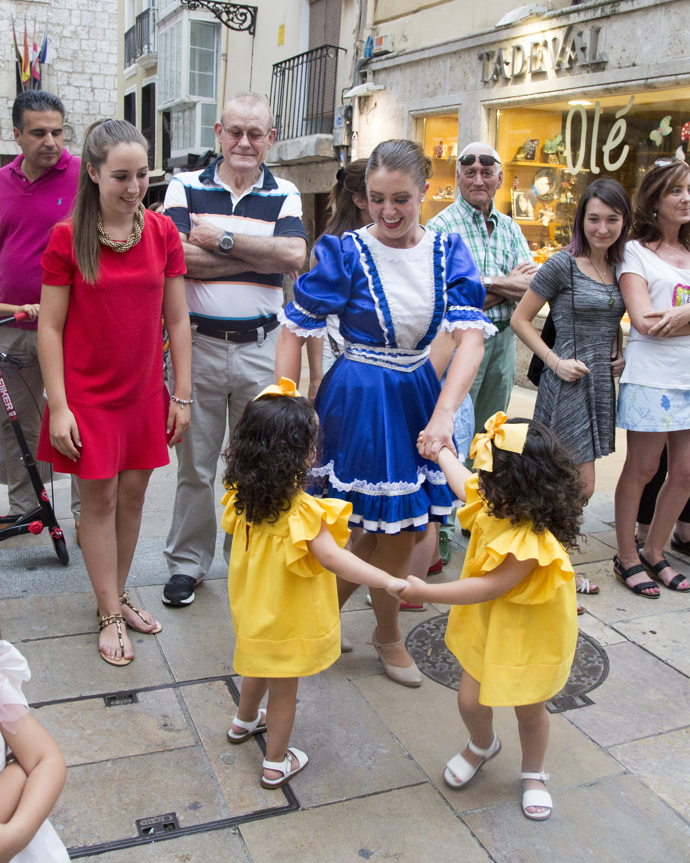 Folk Dancer Kylie Faulk dancing with children in a parade in Spain while attending the International Folkloric Festival 'Ciudad de Burgos' in 2015.