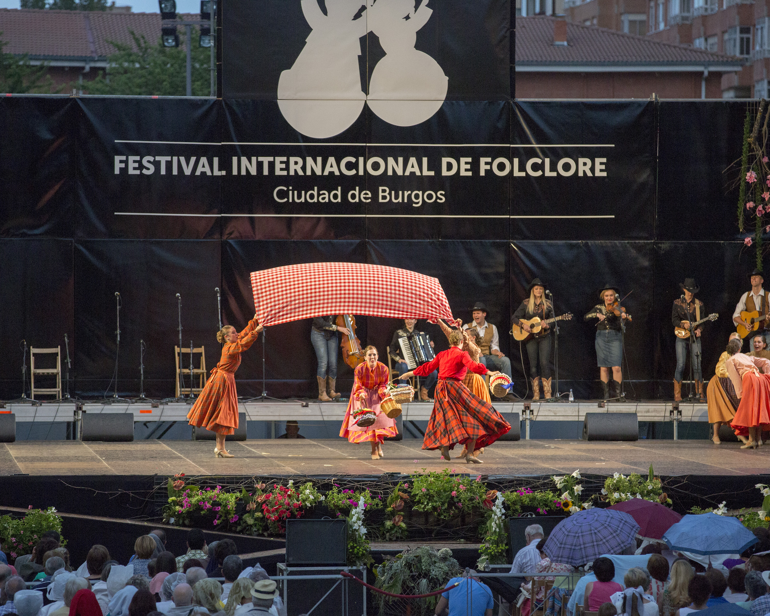 "Folk Dancers Kylie Faulk, Whitney DeMille, Amanda Alley, and Allison Jardine performing the USA ""Jumbleberry Hoedown"" at the International Folkloric Festival 'Ciudad de Burgos' in 2015.