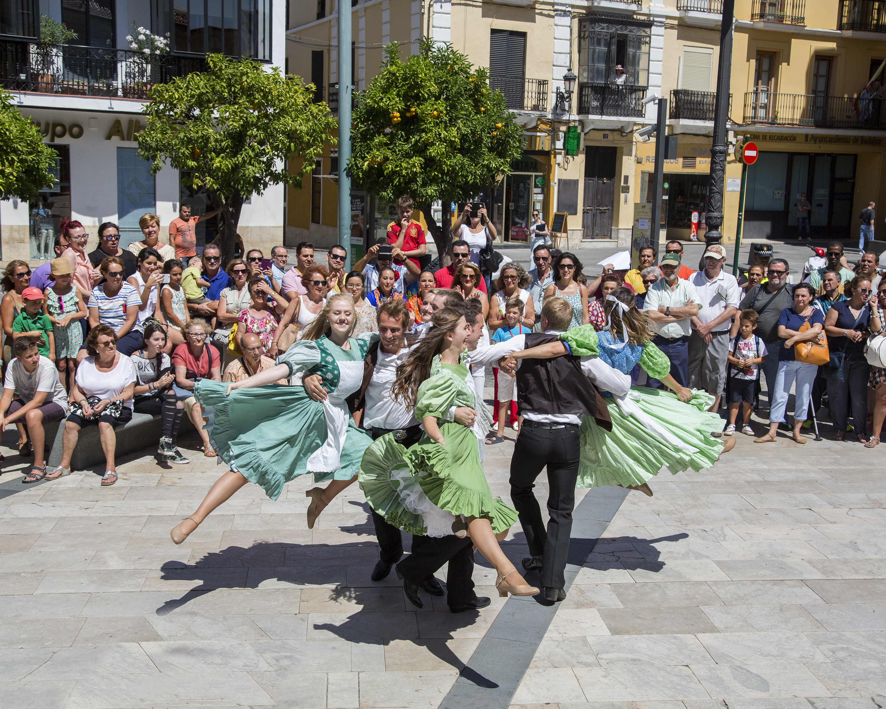 "Folk Dancers Victoria Ringer, Zach Diamond, Thomas Clements, Jessa Richards, Katie Haddock, Taylor Haycock, Abram Allred, and Lauren Piperato performing the USA ""Mary Bee Square"" at the International Folkloric Festival 'Ciudad de Burgos' in 2015. 